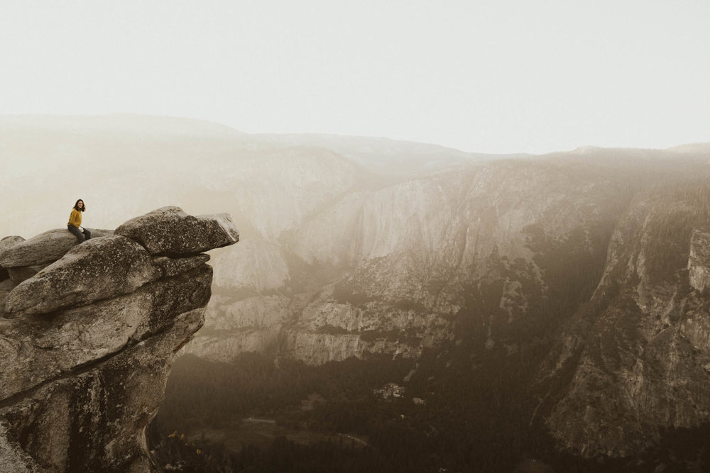 Sitting on top of Glacier Point in Yosemite National Park