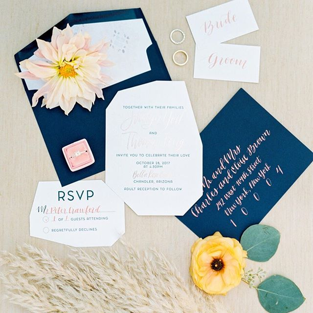 Geometric, graphic paper goods in the color palette by @freedhands were one of our favorite details from Jocelyn & Tommy's big day. With unique shapes and fonts, the paper products stole the spotlight. To see more from this stunning real wedding we were a part of, be sure to check out the latest on the blog. Link in bio. Photography:  @rachaelkoscicaphoto Planners/ Designers: @konsideritdoneweddings Venue: @bellaroseaz Florist: @luxflorist Rentals: @tremaineevents  Macrame Runners: @dang.finerentals Paper Goods: @freedhands Videographer: @thestoryistold DJ: @pushplayentertainment Caterer: @fftk_catering Cake: @lisasrumcake Hair:  @maggiemh Make Up: @ashleydoranxo Bride's Dress: @schaffersbridalaz Menswear: @therealbrotherstailors / @nicksmenswear ⠀⠀⠀⠀⠀⠀⠀⠀⠀ #tremaineevents #tremaineranchblog #freedhands #konsideritdone #bellaroseestate #greylikes #bohobride  #stationery