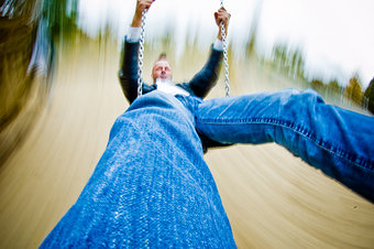 146873-stock-photo-man-joy-playing-speed-perspective-swing