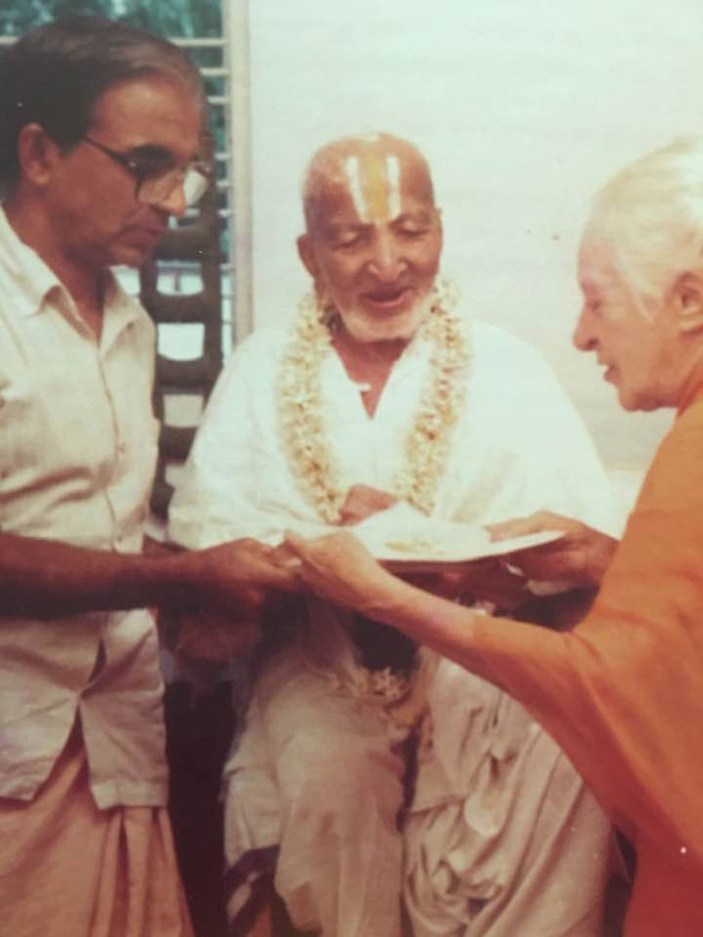 Krishnamacharya with Desikachar (left) and Indra Devi
