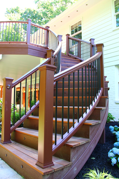 Curved Trex Transcend Stair Railing installed by Highland Renovations in Maryland.