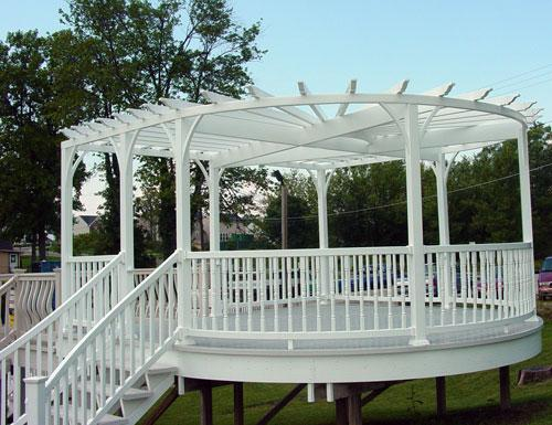 curved-vinyl-pergola-with-curved-vinyl-beam-over-a-curved-vinyl-deck.jpg