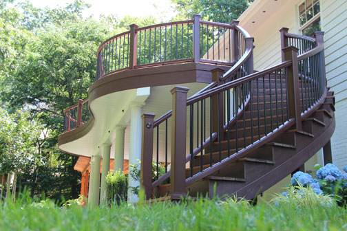 Curved Trex Transcend Deck Railing, Stair Railing and curved Laminated stringers.  Installed by Highland Renovations in Maryland.