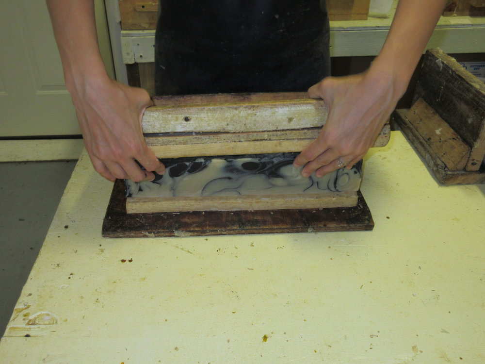 The individual bar cutter- cuts the logs into 3.8 oz bars.