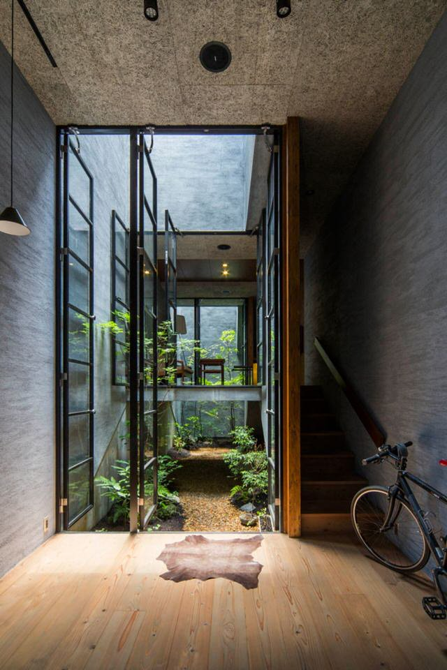 Nara House in Japan, by Fuji Architects. Love the combinations of different textures and levels here. And the way light falls through the centre. Beautiful space!