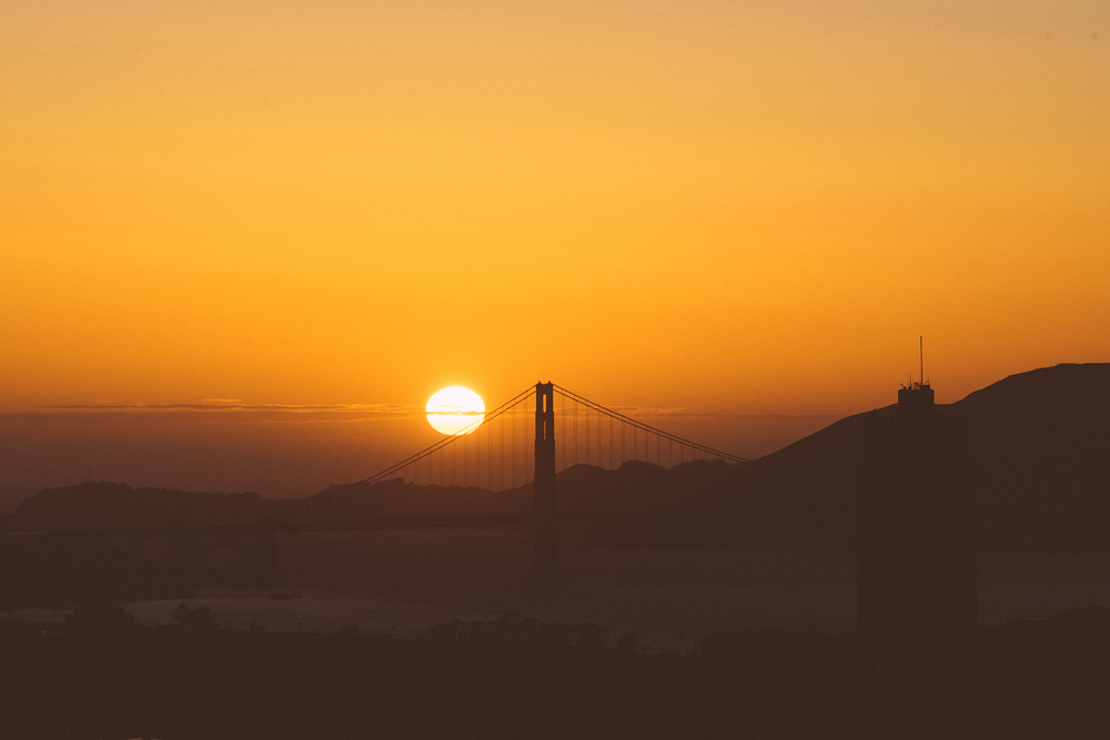 Sun setting over Golden Gate Bridge.