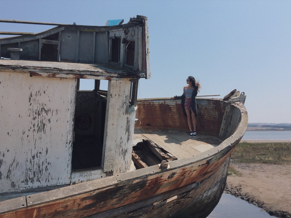 Taking photos with the old rotten ship at bay