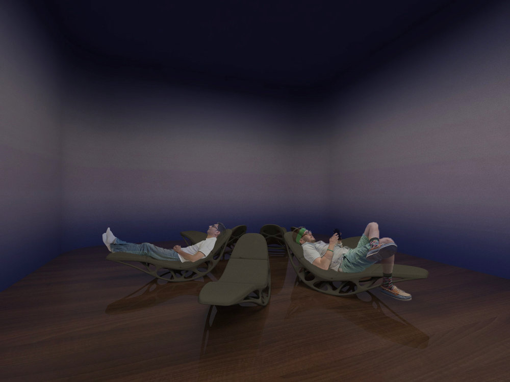 Visitors lie down in a long, curved chaise. It makes a subtle movement back and forth. The room is surrounded by media art that depicts the water and soft waves.