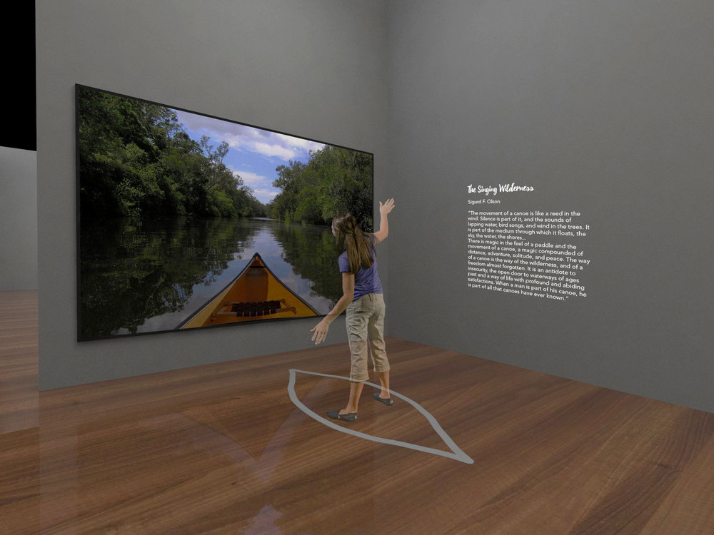 Visitors stand inside a canoe silhouette graphics. The large screen in front is connected to a motion sensor, so experiencing differences according to the selection is possible.
