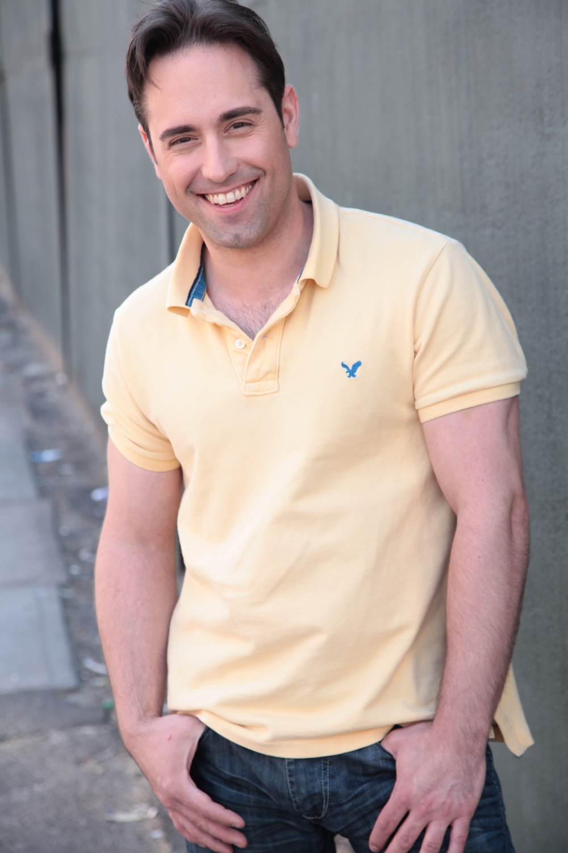 Headshot_Yellow_Smile.JPG