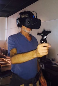 Taken from the @VRLongBeach Twitter page, an attendee gets an HTC Vive and OSSIC demo!