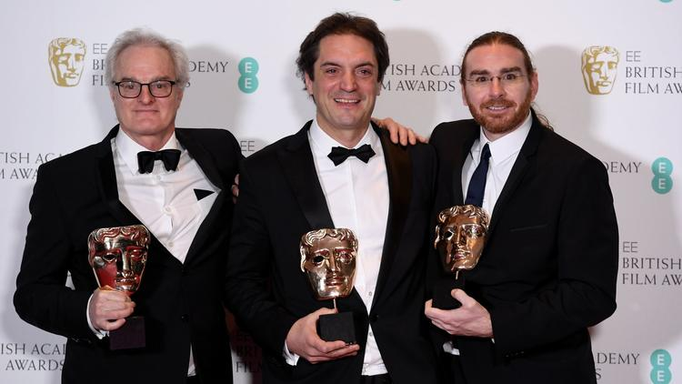 Claude La Haye, Sylvain Bellemare and Bernard Gariépy Strobl at the British Academy Film Awards in February back in February. Picture credit.