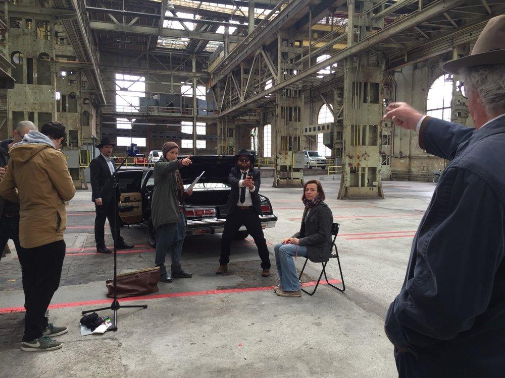 "Shooting Inspector Crazy Schuss & Kuss. The Crew was 1 director 1 A.D. & ""spherotographer"" (me), 1 sound engineer, 4 actors and one intern"