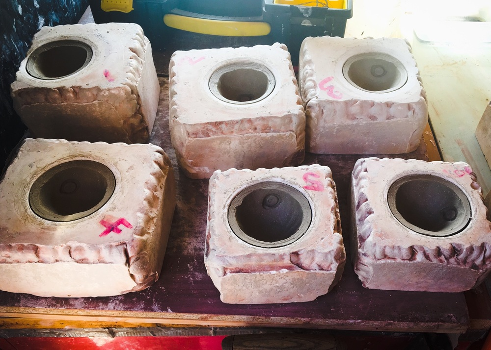 Clay going through the drying process inside moulds.