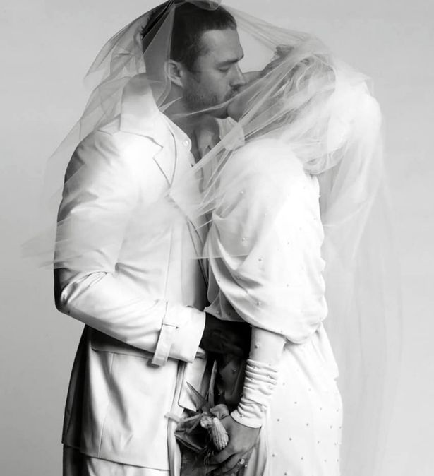 Lady Gaga kisses her groom Taylor Kinney.jpg