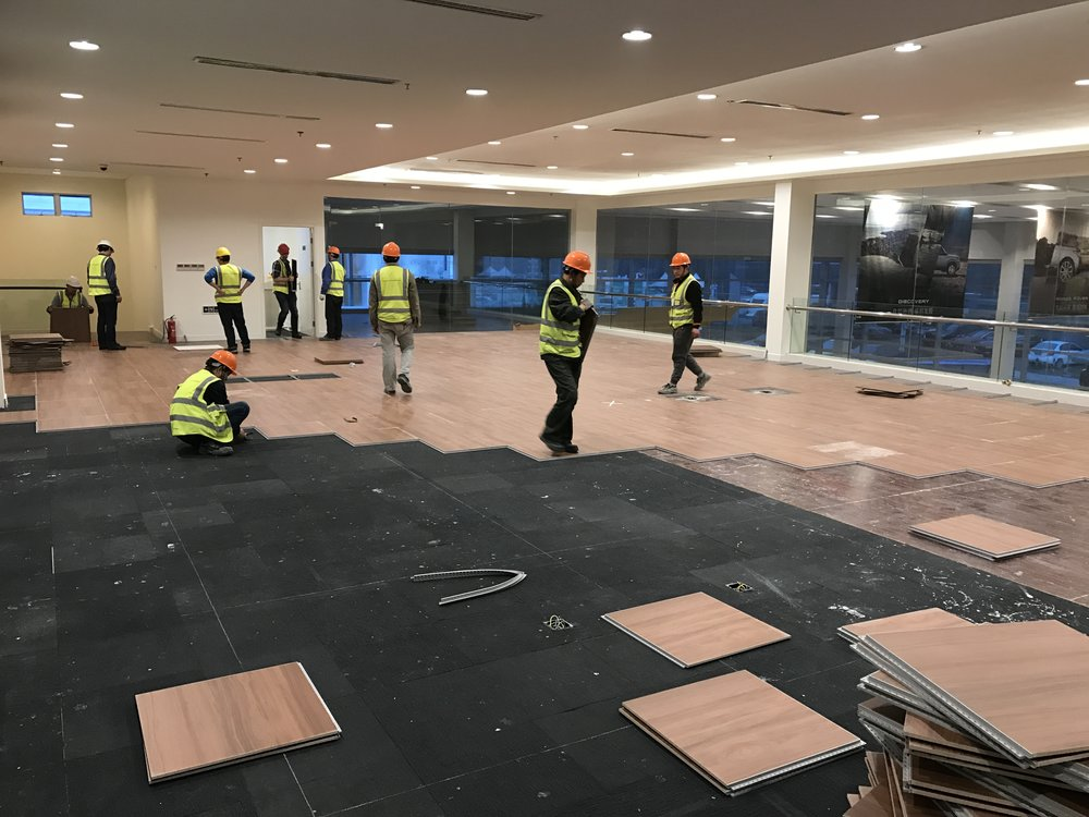 Installation day 1: Versaflex® cross installed in lounge area (adjacent to main showroom) directly on multiple substrates of LVT and carpet tiles