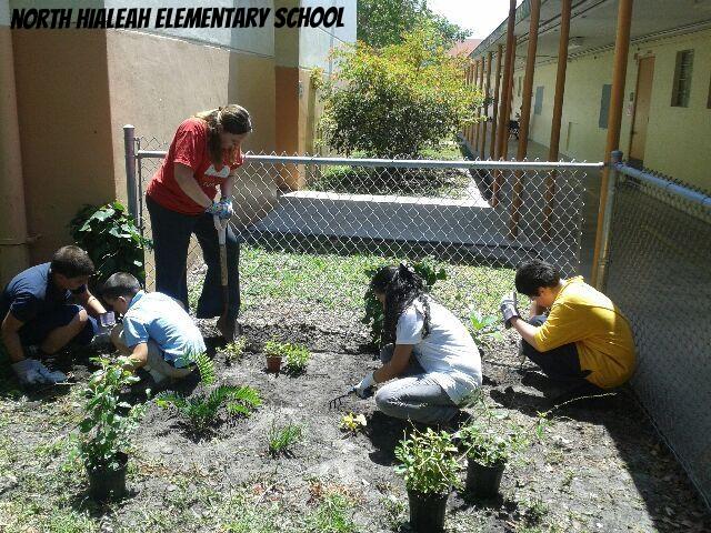 Students_Teacher_garden_prep(2).jpg
