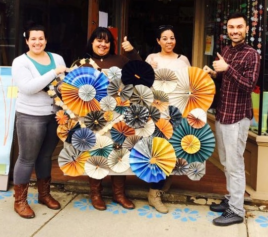 One Friday a few months back the friendly people at The Hispanic Business Center came to our shop to make a collective piece of art to hang in their office.  We all loved the way it turned out!