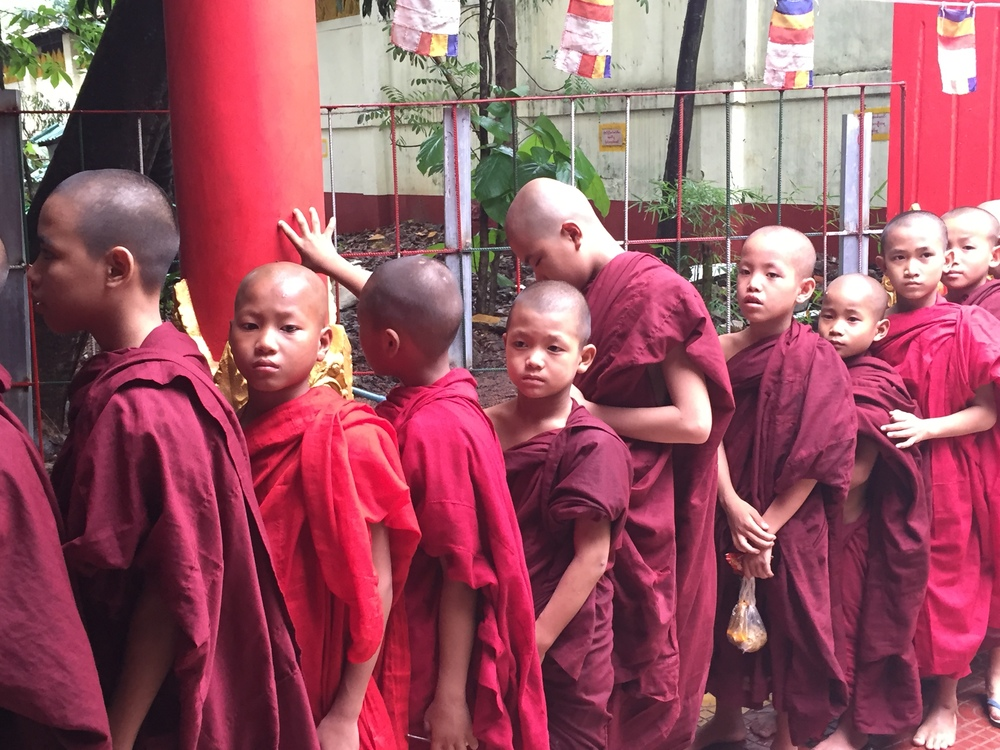 Buddhist Monks lining up for lunch