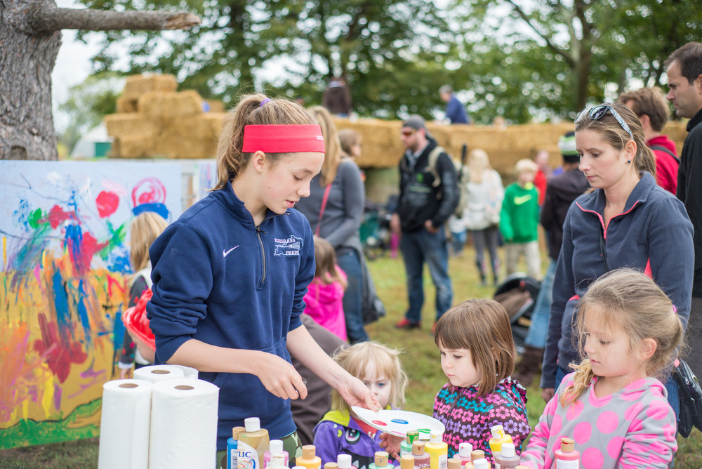 A CFAC student volunteers at the Foxhollow Farm Festival