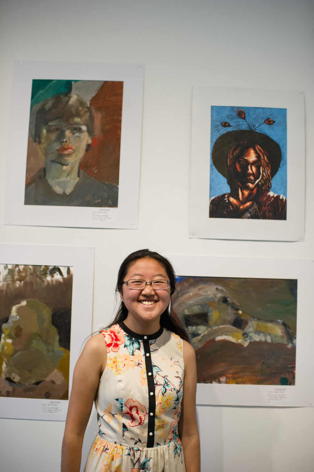 MuMu Lin stands under her print created in Dennis Whitehouse's class.