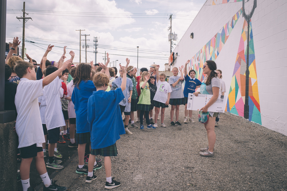 Liz Richter works with elementary school students at the Hikes Point Mural   through Center for Neighborhoods' PAINT program.