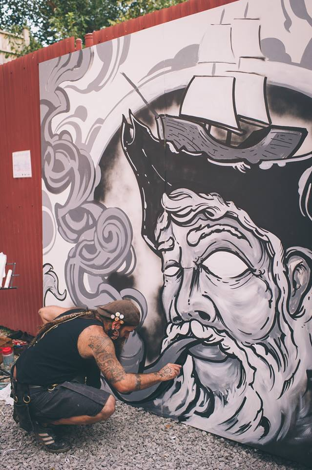 Vinnie Kochert at work on his mural at MAPPED OUT.