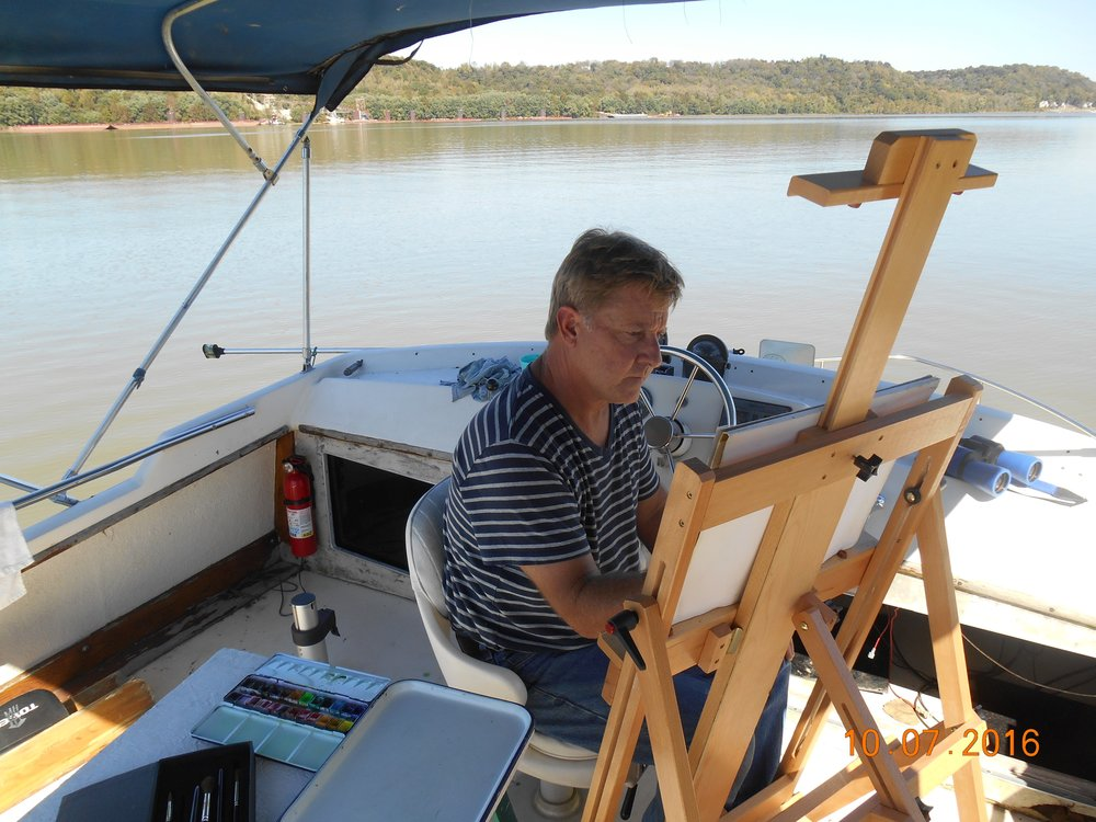 A photograph of Ray Kleinhelter at work on his boat (2016).