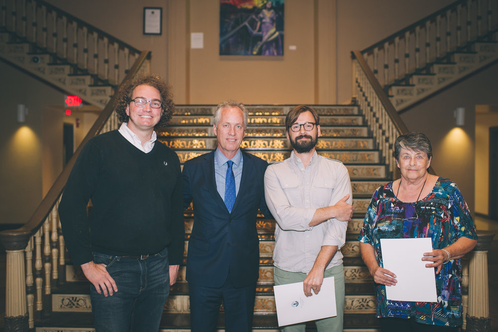 Metro Hall exhibiting artists Damon Thompson, Noah Hewett-Ball, and Sherry Pearl with Mayor Greg Fischer.