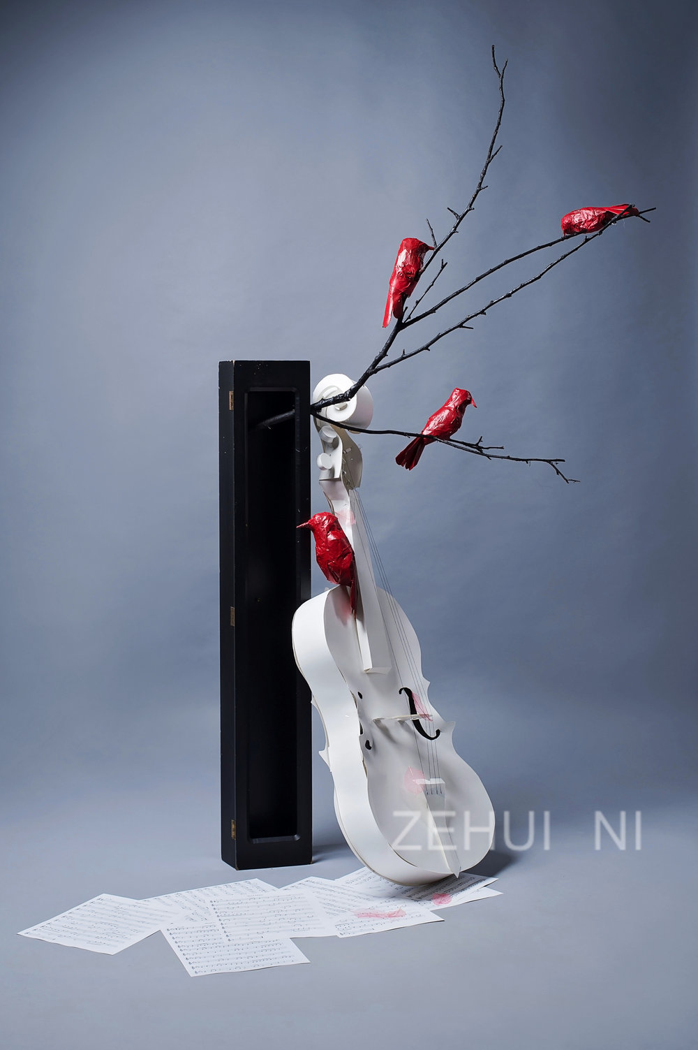 """Red birds on Violin"" by Zehui Ni, 26x22x55in, wood, string, acrylic paint, tape, metal, paper, found branches 