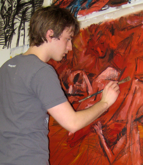 joshua jenkins. a much younger jenkins working on painting in his college studio (back 2008 joshua