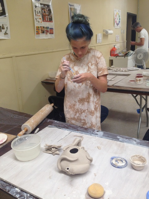Andrea Priddy working on her octopus teapot.