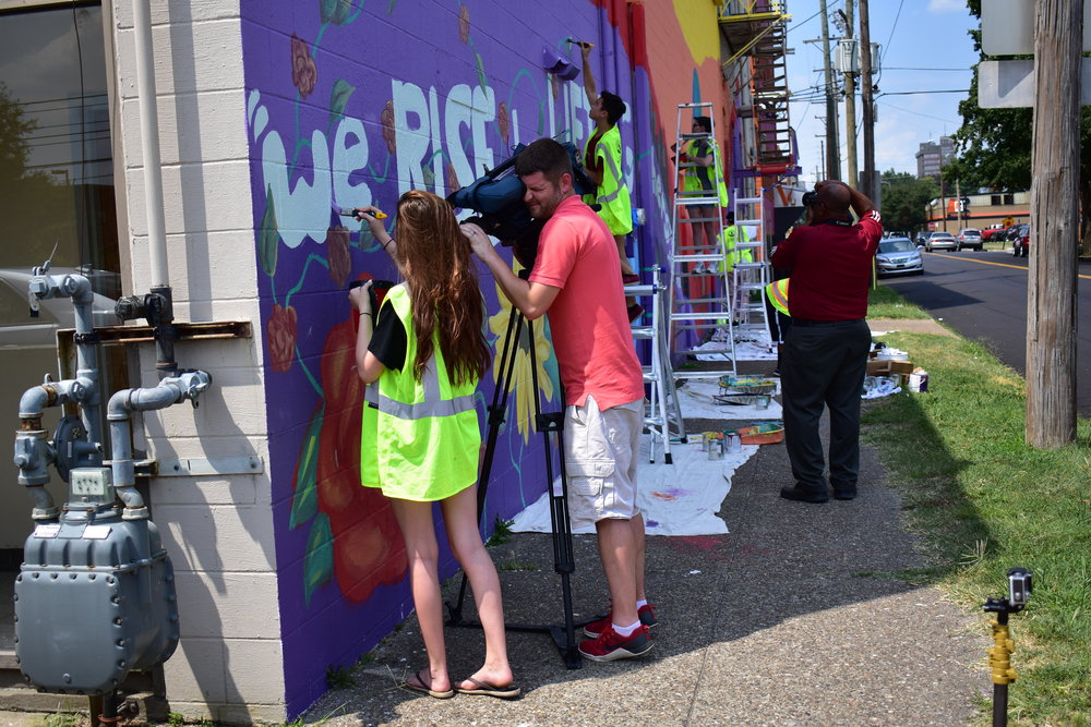 Filming underway at the Christ Way Missionary Church Mural.