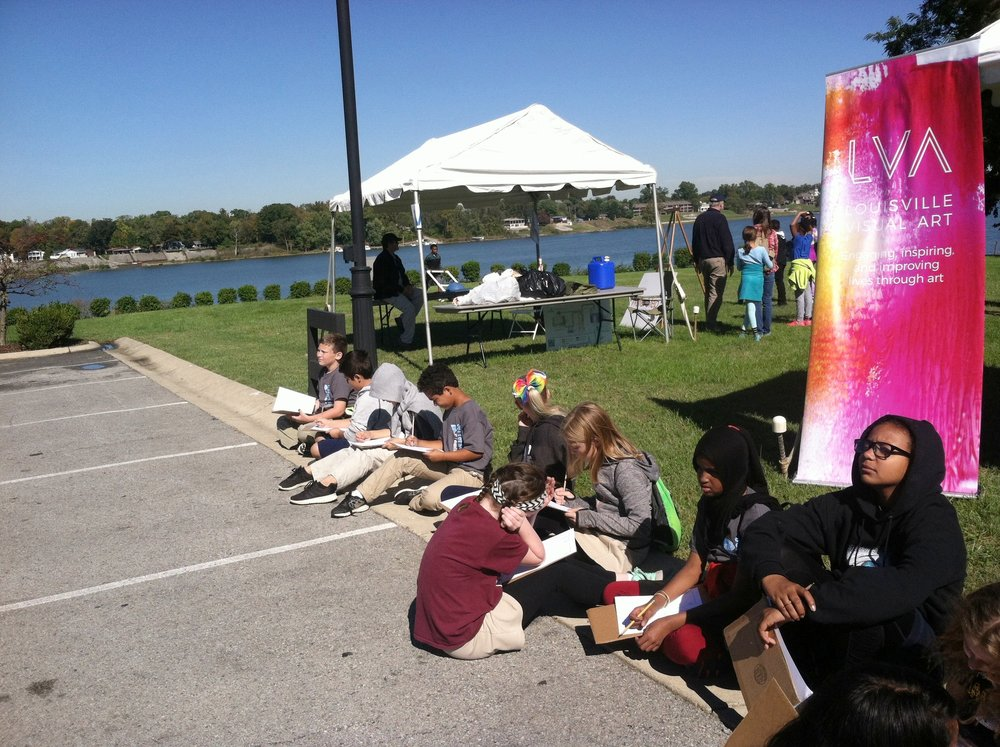 It couldn't have been a better day for drawing beside the river.    The teachers went home with Water Tower Trading Card instructions for two different games and our project will continue to grow at school.