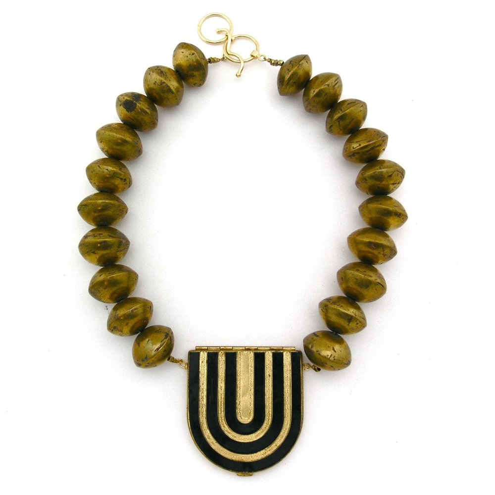 """U-turn"" by Emily Maynard, hand-wrought brass beads from Mali, Art Deco enamel and brass compact pendant, gilt copper toggle clasp, 2017"