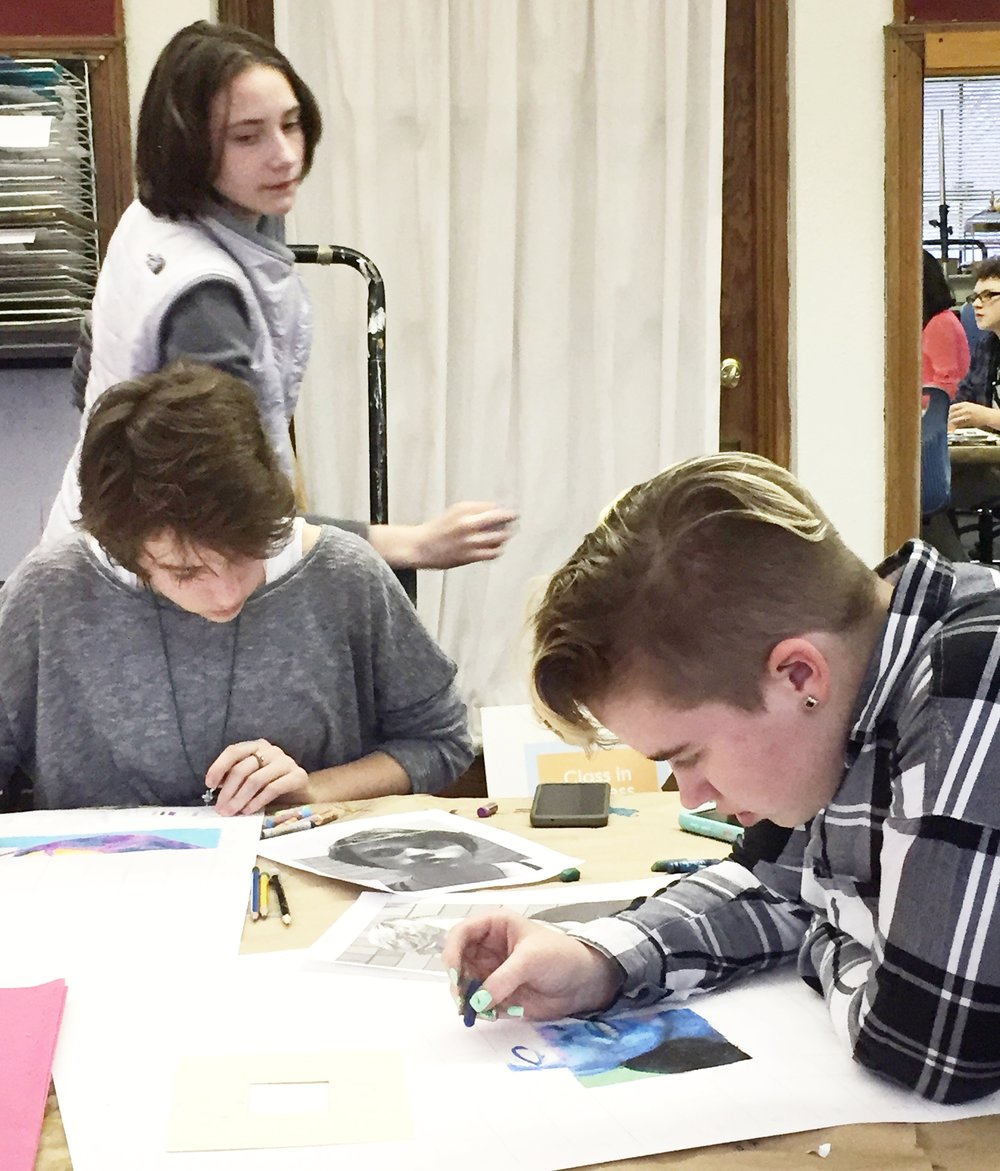After doing small projects about line, shape, color, and shading, our Clifton middle school CFAC students are creating self-portraits with instructor Liz. Square by square, they are blending colors and seeing their likenesses appear!