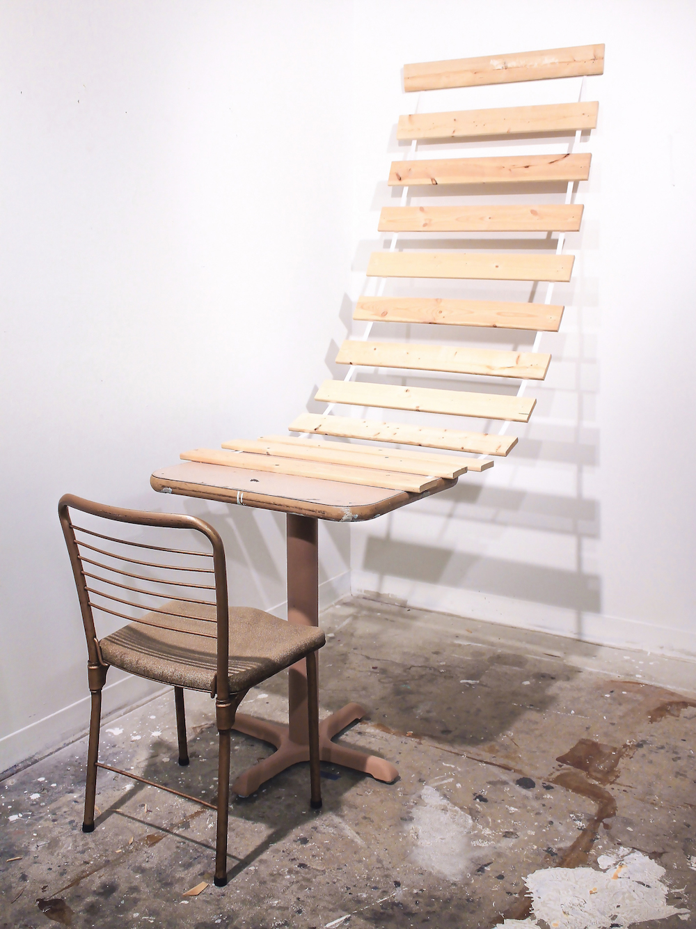 """Learning Curve"" by Shane Smith, Chair and table and bed slats and nails, 17x3x5 ft, 2016, NFS"
