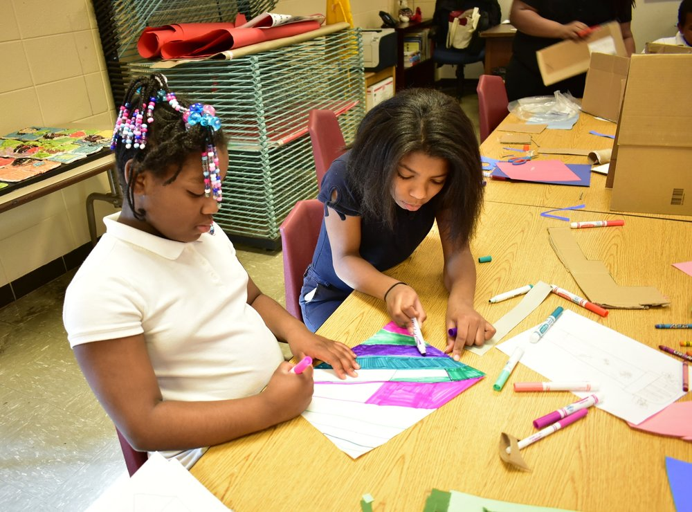 Fourth graders at Price Elementary are collaborating in small groups to design and construct their own unique Water Towers. This is the first day of construction - recycled materials, art supplies, a lot of imagination, and trial and error make for a fun and different learning experience.  The project is sponsored by the Water Co. Foundation and the Fund for the Arts. The project also includes a field trip to the Water Works Museum and a Family Fun Day event at the Water Tower.