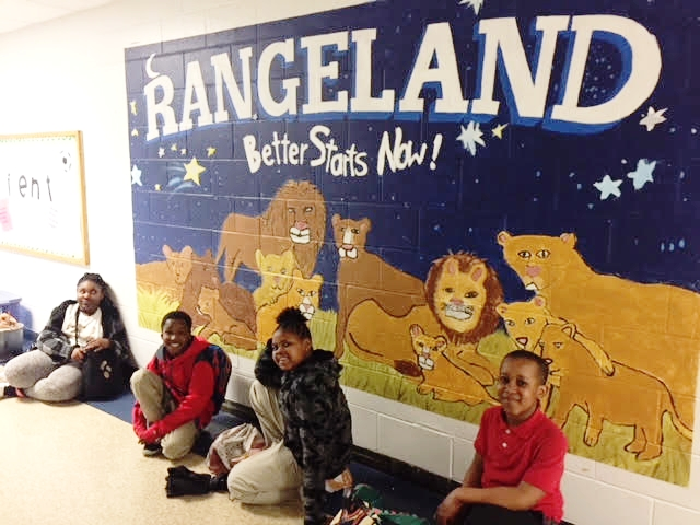 """Better Starts Now"" is what the students from Rangeland Elementary hear over the loudspeaker frequently - words of wisdom from their principal, Dr. Kiggins. So when it came time to brainstorm about their mural project, the 4th and 5th- grade Rangeland Lions decided to play with the words ""Stars and Starts"" and roared into action.  With direction from their fearless teacher, Taylor Uttley, and LVA educator Annette Cable, the students drew big lions, little lions, caring lions and brave lions lying under a blue sky-filled with stars.  Withe all the snow days, our 8-week project turned into a 12-week project, but with brushes and house paints in hand, the artists painted and helped each other finish their mural with tons of PRIDE!"