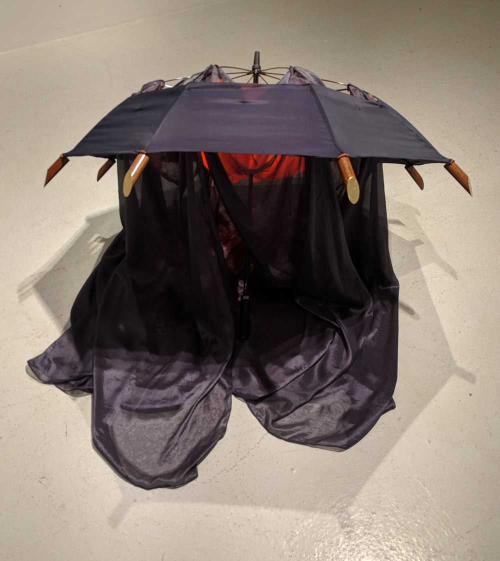 """Navy and orange personal enclosure"" by Tammy Burke, umbrella frame, wood, gold leaf, synthetic fabrics, 56x56in, 2018"