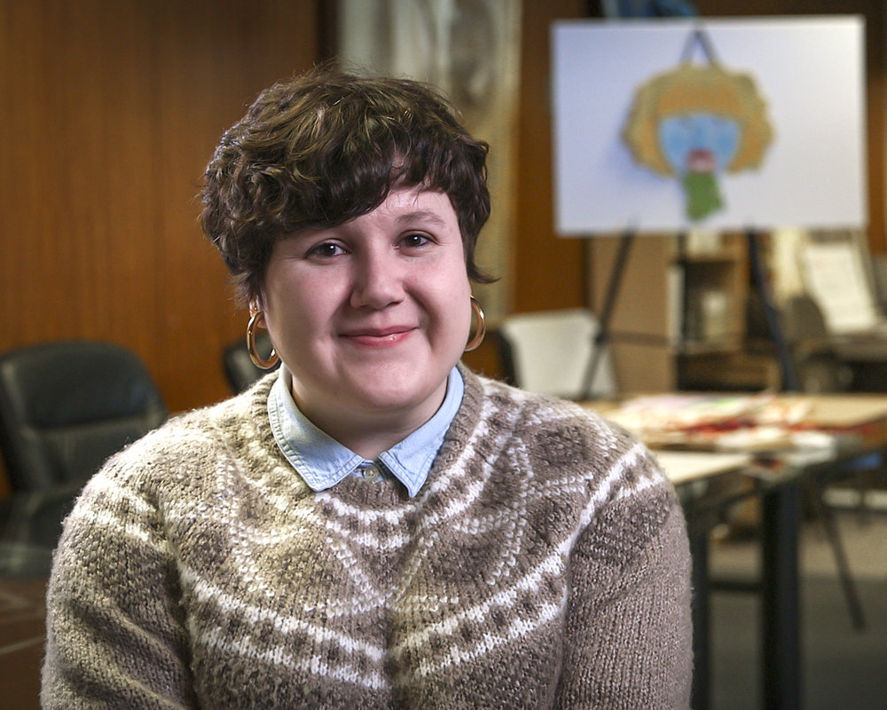 Monica Stewart, Master of Fine Arts Candidate, seated in Louisville Visual Art's Lytle Street offices, 2019.