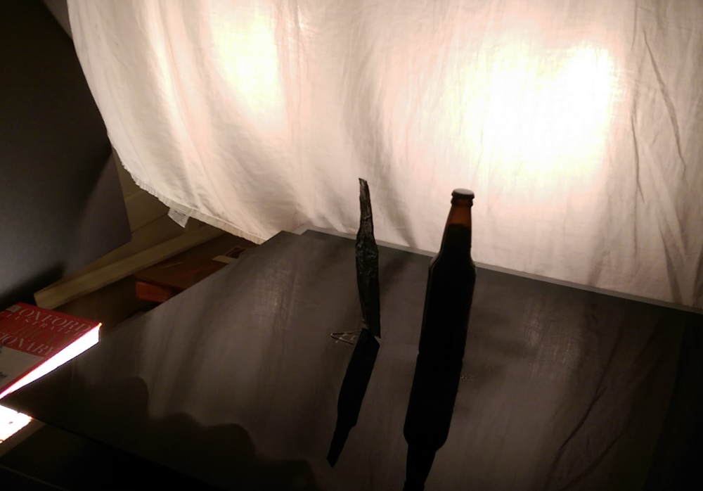 Bottle-shaped foil reflector shown here behind the bottle