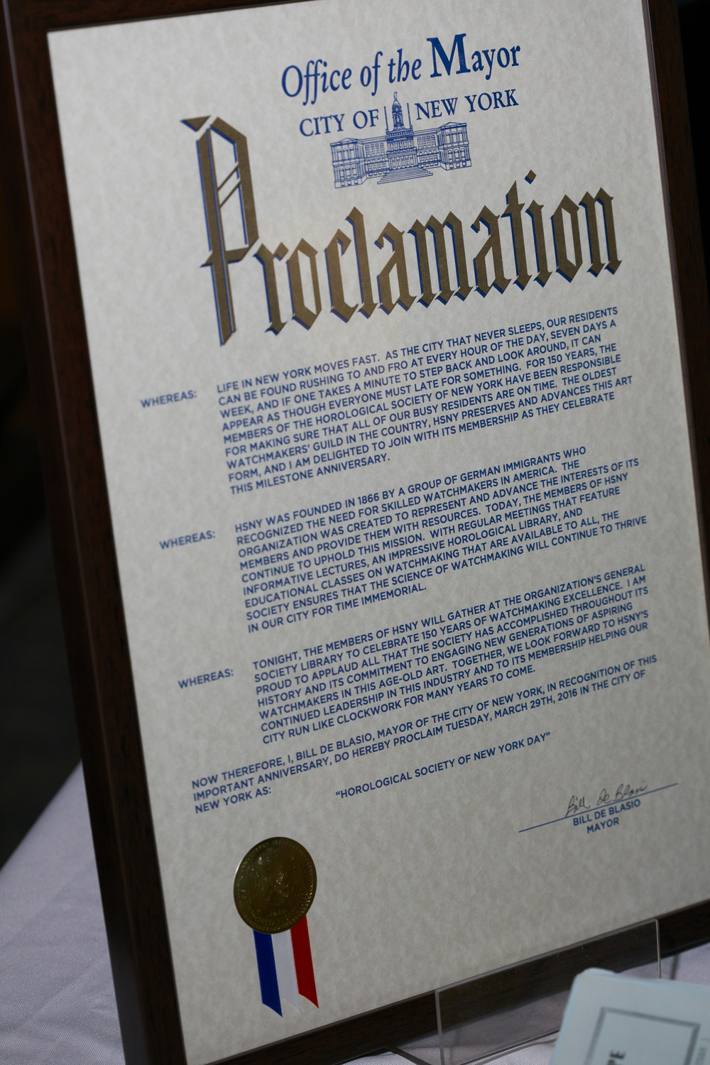 "Proclamation from NYC Mayor Bill de Blasio naming March 29, 2016 as ""Horological Society of New York Day"""