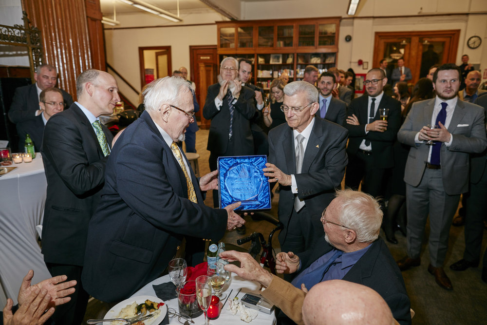 Charles Salomon (right), HSNY Treasurer & Fellow, presenting the Howard Fass Award to Hans Weber (left), HSNY Trustee & Fellow (1932 -2018), at HSNY's 150th Anniversary Gala, 2016.