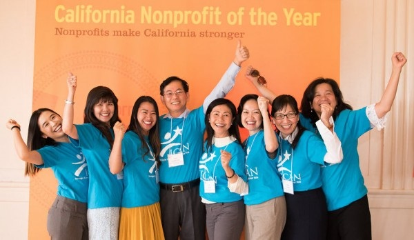 Copy of Nonprofit of the year photo with banner.jpg
