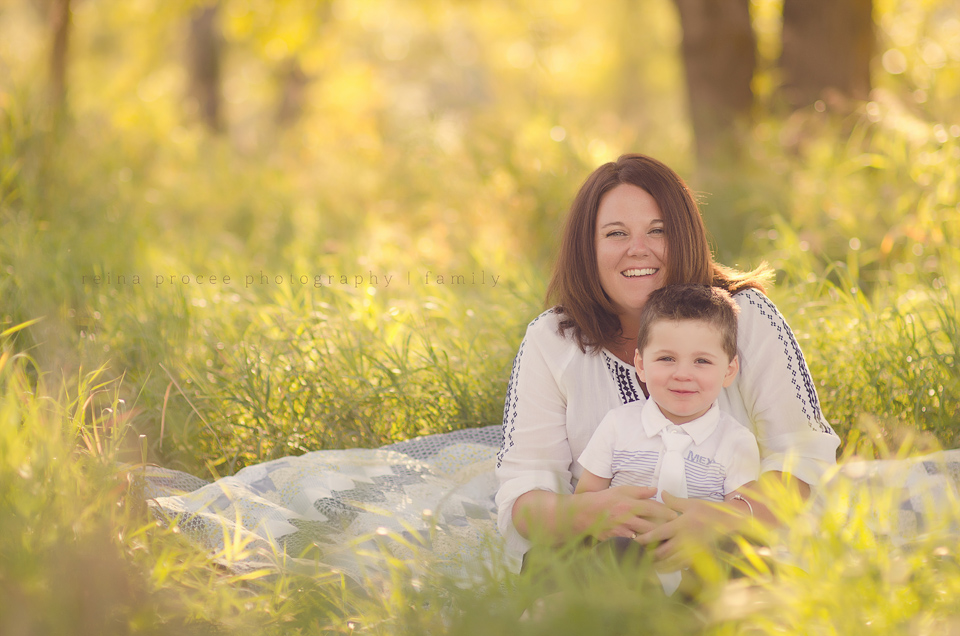mom and son in field with sunlight family photos