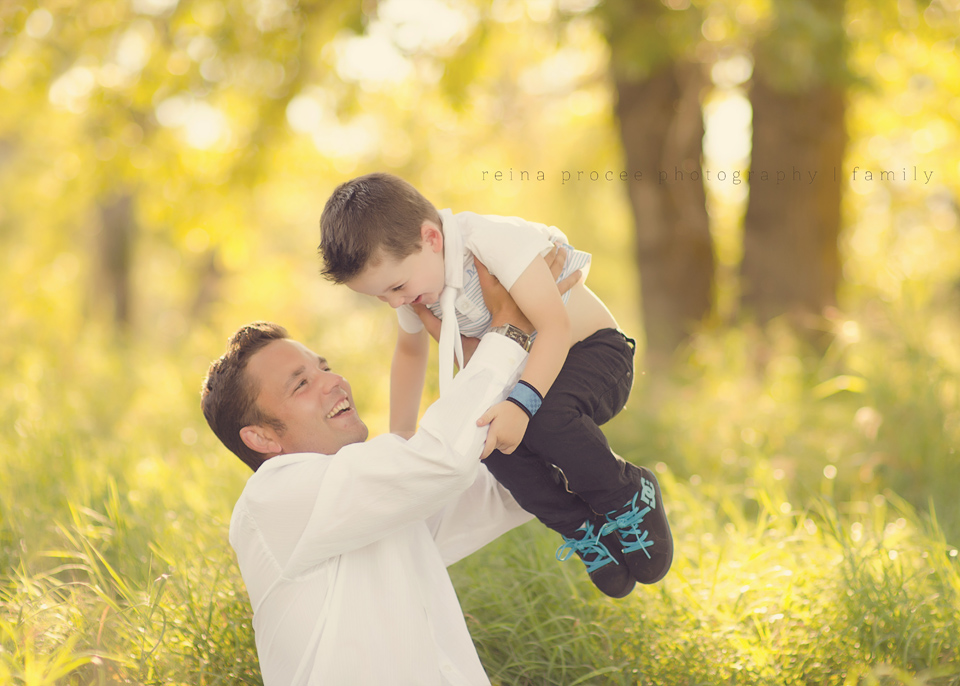 dad and son in field with sunlight family photos