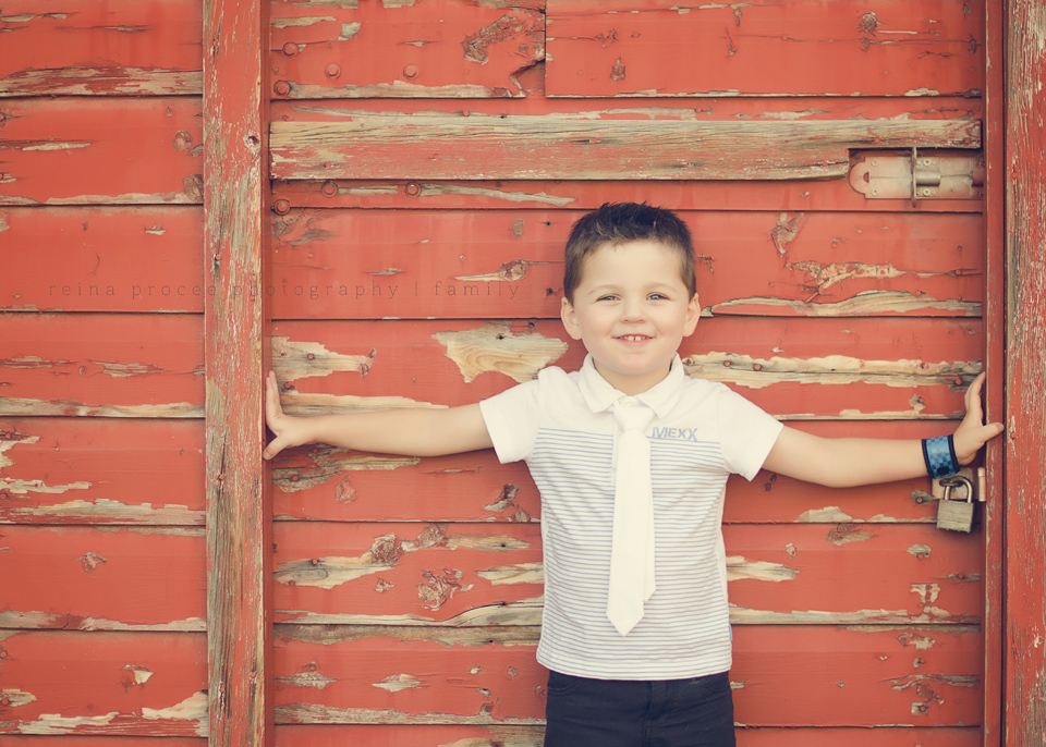 little boy in front of barn family child photos