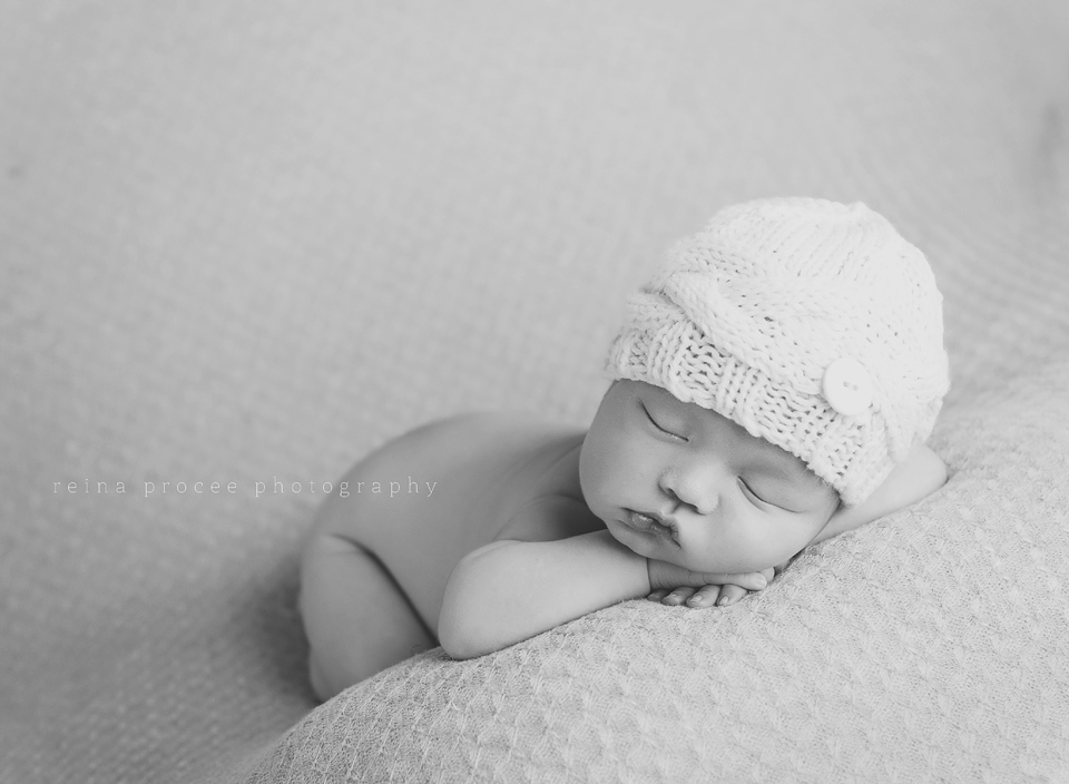 black and white of baby boy sleeping