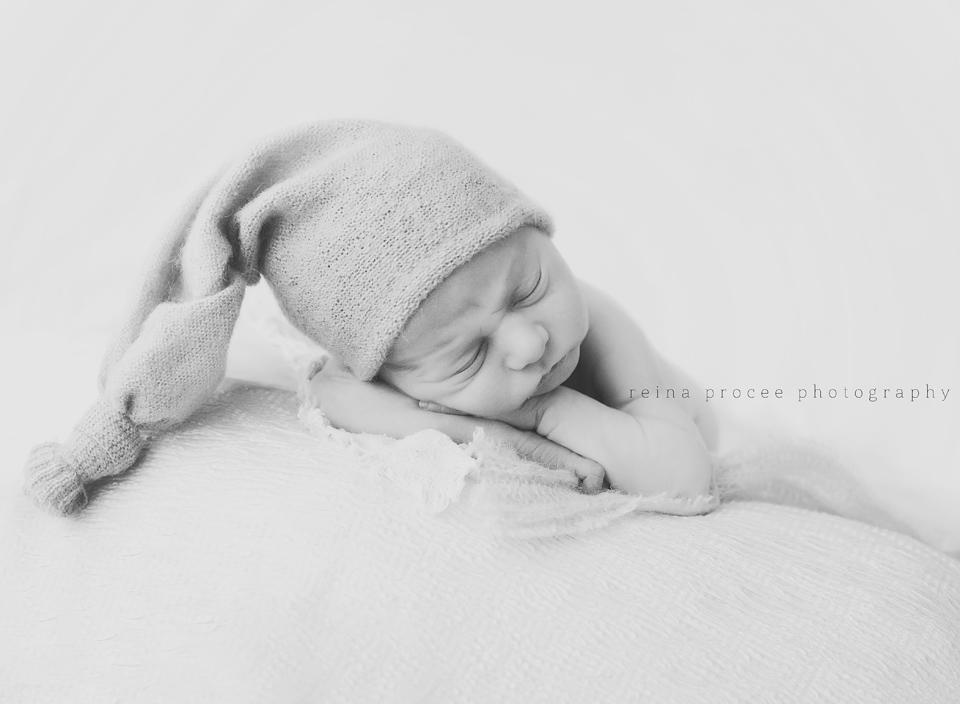 baby boy sleeping with long hat